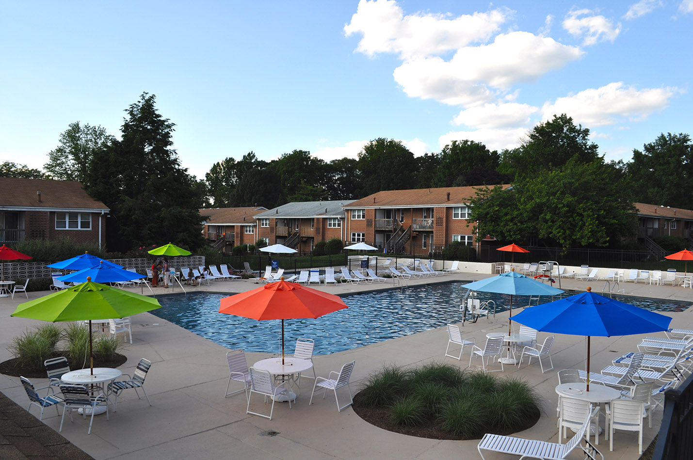 Outdoor shot of Radwyn Pool area with umbrellas, tables, and lounge chairs